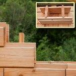 Дом из деревянных кирпичей и стружки
