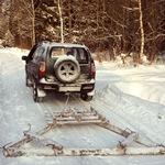 Чистим снег покрышкой от трактора