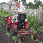 Окучивание минитрактором Белорус -132Н