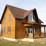 Садовый домик с открытой верандой каркасной конструкции